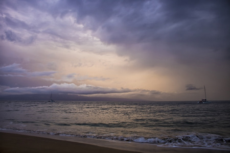 Dramatic clouds in sunset seascape as storm hurricane approaches island