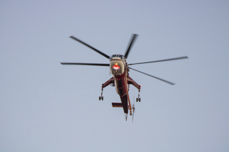 Water Dropping Helicopter Flies Overhead During California Wildfire