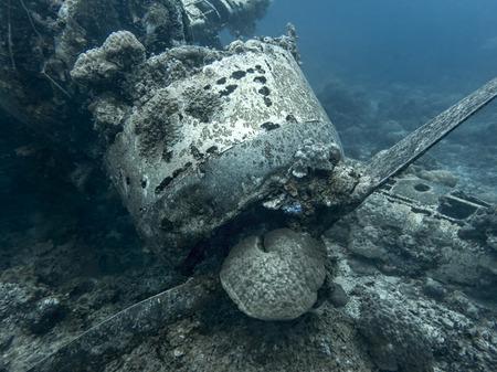 Jake seaplane wreck engine and propeller sit on ocean floor in Palau.