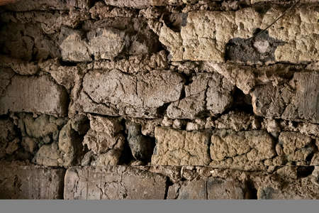 Detail of old adobe wall made of mud and clay bricks. Stock fotó