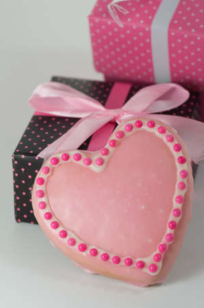 Pink cookie with black polka dot box Stock Photo