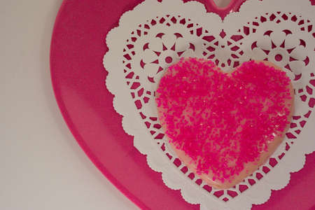 Pink cookie on lace plate