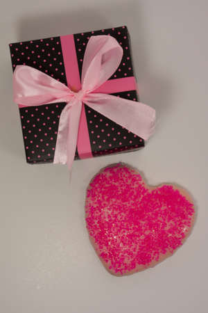 Box and Pink Valentine Cookie Stock Photo