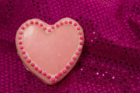 Pink Valentine s cookie on background