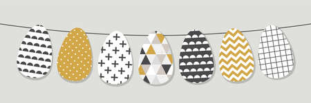 Cute Scandinavian Easter eggs bunting as horizontal banner with geometric tribal ornament in black, white and gold colors of ethnic patterns