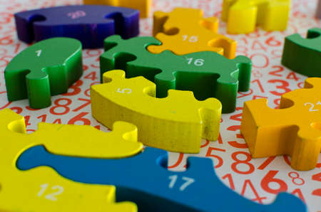 puzzles and colored figures with numbers and letters used in occupational therapy, for rehabilitation or learning Stockfoto
