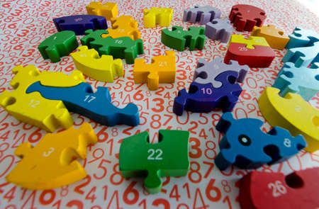 puzzles and colored figures with numbers and letters used in occupational therapy, for rehabilitation or learning Stock Photo
