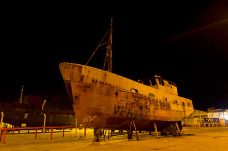 Fishing boat hull for sale at the port Editorial