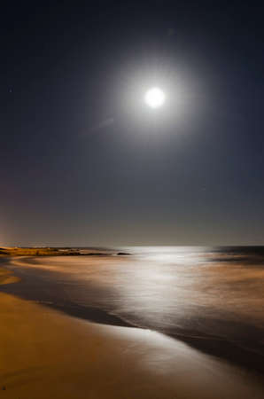 long exposure on the beach with a full moon
