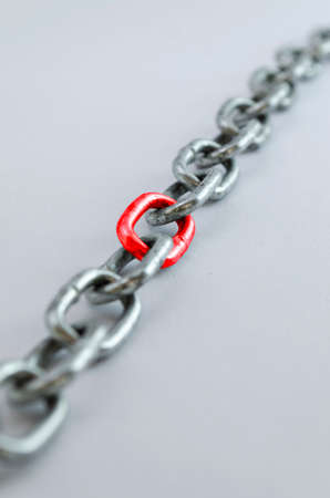 Diagonal metal chain, with red link