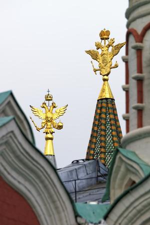 national  emblem: Golden eagles national emblem of Russia in the tower peaks