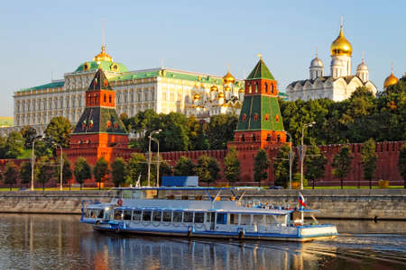 Holiday cruiser in Moscow river in front of Moscow Kremlin photo