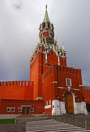 clocktower: Clocktower on the Moscow Kremlin on the Red Suare and the Kremin entrance gate against the cloudy sky