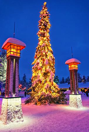 rovaniemi: Christmas tree in Santa Claus village at Arctic Circle near Rovaniemi Editorial