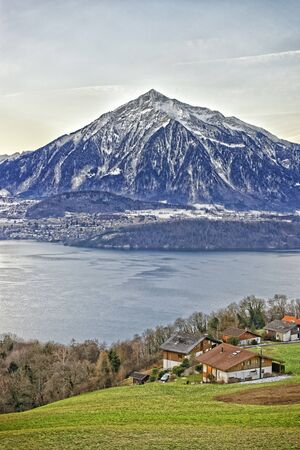 lakeview: Beutiful Niesen Mountain and lakeview near Thun lake in Swiss Alps in winter Stock Photo