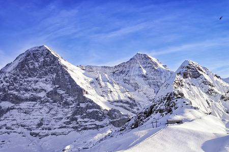 monch: Swiss Tschuggen, Monch and Jungfrau peaks in winter Stock Photo