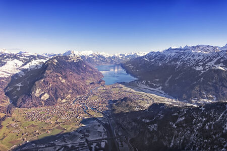 aerial view city: Aerial view city of Interlaken, airport and Brienz lake