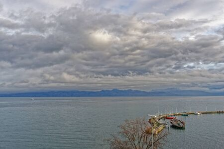 lac: Lake view over Lac Leman in  Evian-les-Bains in France in the New year in winter Stock Photo