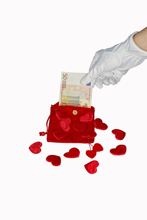 fifty euro banknote: Red purse with red hearts and fifty euro banknote Stock Photo