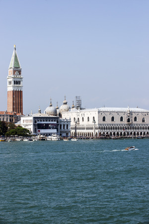 doges  palace: Doges palace, campanile of St. Marco, St. Marco lion statue  and water traffic in summer Venice