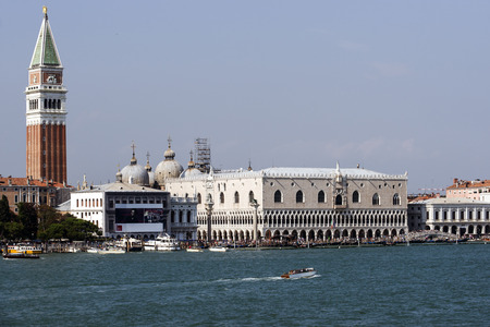doges  palace: Doges palace, campanile of St. Marco, St. Marco lion statue, schiavoni quay  and water traffic in summer Venice Editorial