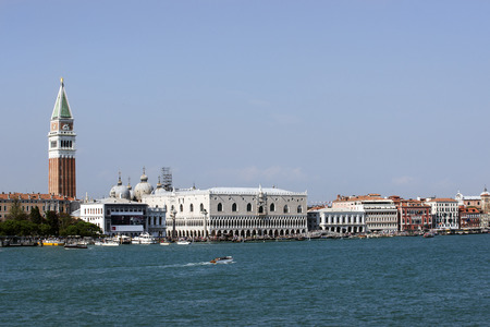 doges  palace: Schiavoni quay,  doges palace, campanile of St. Marco, St. Marco lion statue  and water traffic in summer Venice