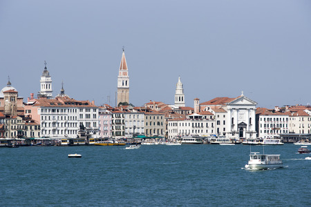 the campanile: Skyline with Campanile of st. Marco, domes and bell towers and water traffic in summer Venice