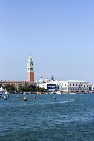 doges: Doges palace, campanile of St. Marco, St. Marco lion statue  and water traffic in summer Venice