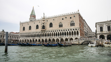 doges  palace: Gondolas parking near Doges palace, campanile of St. Marco, St. Marco lion statue in summer Venice