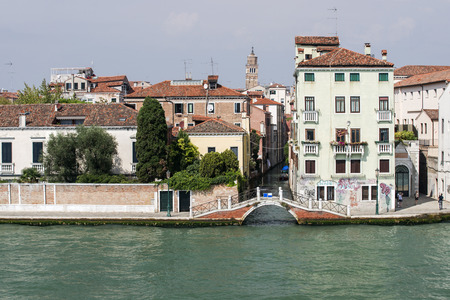quay: Quay and bridge over small queit channel in Venice Stock Photo