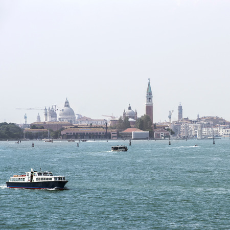 waterbus: Water traffic of water-bus and civil boats in summer Venice