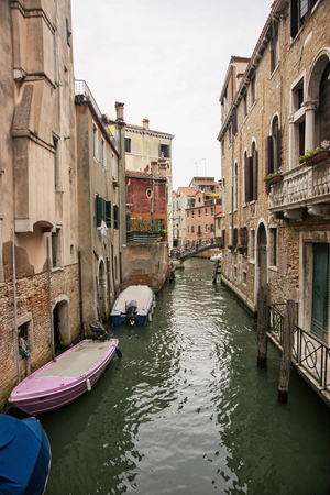 motorboats: Narrow channel in Venice with citizen motorboats parked Stock Photo