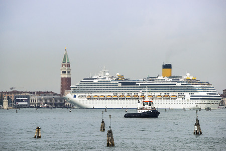 tug boat: Tug boat and cruise liner in front of Doges palace Campanile of St. Marco, St. Marco lion statue in summer Venice Editorial