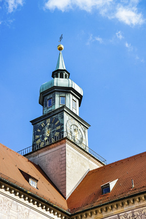weather front: Clock tower in Munich in front of blue sky in fair weather Stock Photo