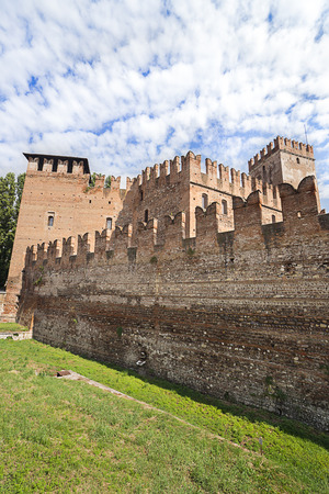 crenelation: View to old castle walls in Verona in summer Editorial