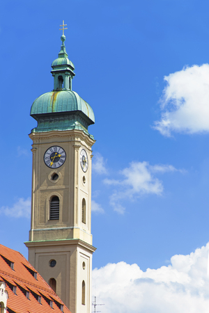 crux: Clock tower of cathedral in Munich in front of blue skies Stock Photo