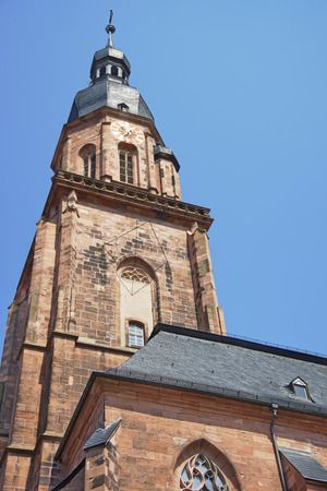 spire: Wall fragment, clock tower and spire of Cathedral of Holy Spirit in Heidelberg at sunny weather