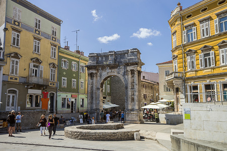 an era: PULA, CROATIA - AUGUST 29, 2013: Triumphal arch of Roman antique era in Pula