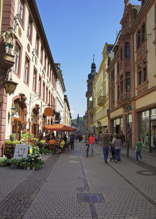 heidelberg: HEIDELBERG, GERMANY - MAY 5, 2013: People walking on central pedestrian street in Heidelberg at sunny weather