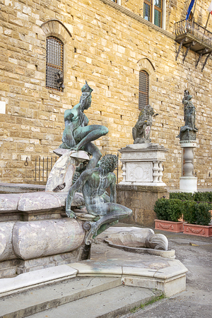 signoria square: Fountain of Neptune  near the Old Palace (Palazzo Vecchio) on Square of Signora (Piazza della Signoria) in Florence in Italy in summer