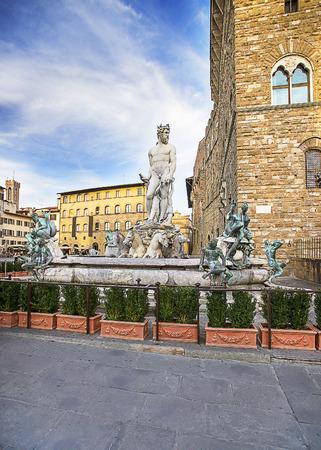 signoria square: Neptune fountain near the Old Palace (Palazzo Vecchio) on Square of Signora (Piazza della Signoria) in Florence in Italy in summertime Editorial