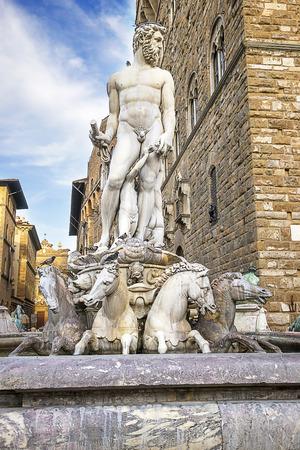 signoria square: Neptune statue near the Old Palace (Palazzo Vecchio) on Square of Signora (Piazza della Signoria) in Florence in Italy in summertime