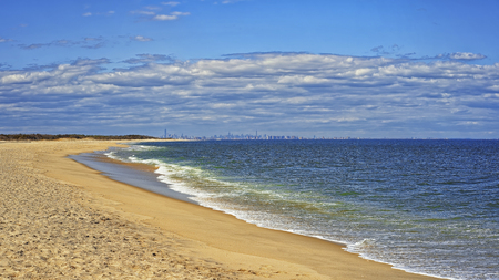 water view: Ocean shore and view to NYC from Sandy Hook, NJ at windy weather Stock Photo