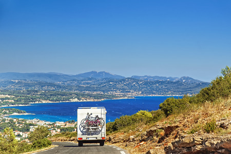 caravan: Caravan on the road at the mediterranean shore Provence Cote dAzur in summer Stock Photo