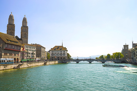 grossmunster cathedral: Zurich city center and Limmat quay in summer with Grossmunster cathedral domes Stock Photo