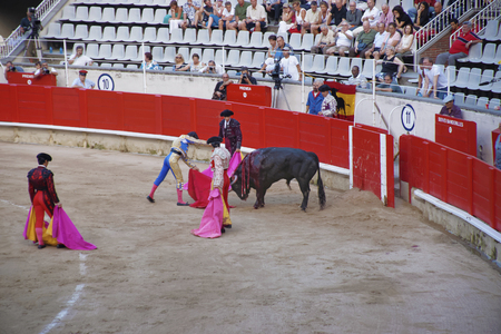 corrida: BARCELONA, SPAIN - AUGUST 01, 2010: Torero, performaing a Spanish national amusement - corrida bullfighting. Barcelona, Catalonia, Spain