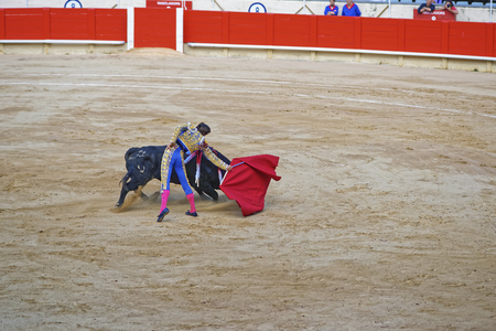 proficiency: Bullfighter demonstrates his talent and proficiency during a bullfighing show in La Monumental arena. Barcelona, Catalonia, Spain