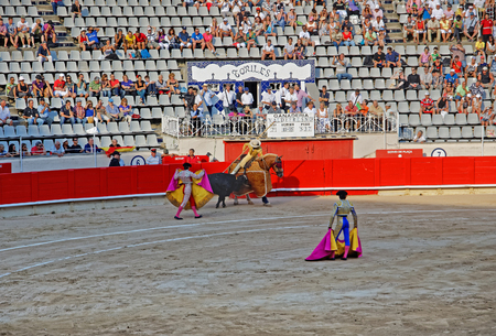 monumental: BARCELONA, SPAIN - AUGUST 01, 2010: Matador torero kills a bull in the bullfighting arena of La Monumental, Barcelona, Catalonia, Spain