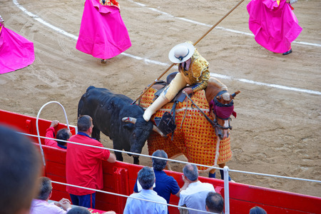 corrida: Spanish matador is wounding the bull at the arena of Plaza Monumental de Barcelona La Monumental during a bullfight corrida on August 01, 2010. Barcelona, Catalonia, Spain