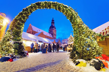 boughs: RIGA, LATVIA - DECEMBER 28, 2014: Entrance to the Christmas Market in Rigas Old Town made of spruce boughs and fairy lights. Riga, Latvia Editorial